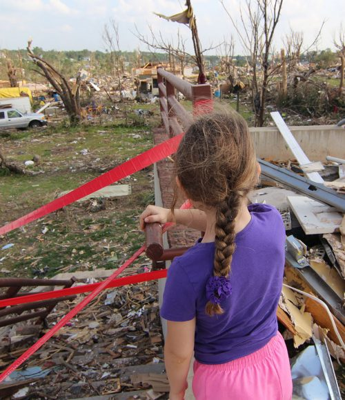 Girl surveys tornado damage Joplin MO May 5, 2011